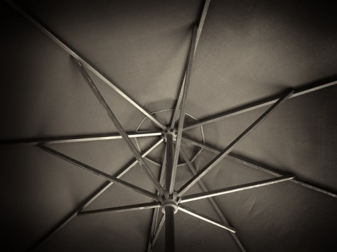 Underside of an umbrella in black and white