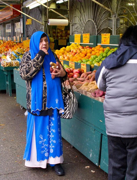 Woman dressed in bright blue at a food market