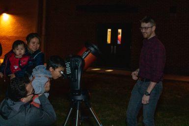 Space Ambassador Justin showing views through a telescope