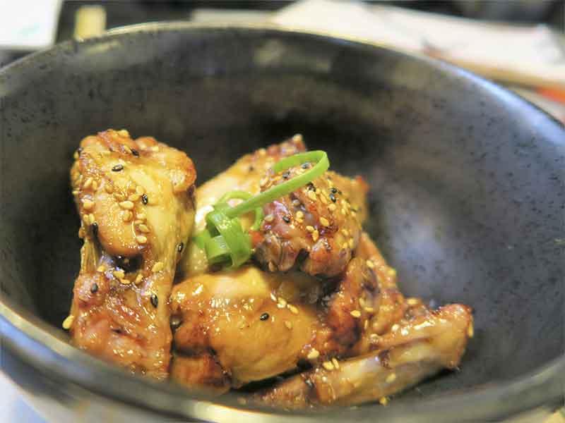 Chiferas alas de pollo restaurante Capon cocina Chifa y Nikkei
