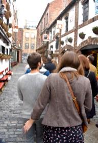 Belfast food tour group walking streets gastrogays behind