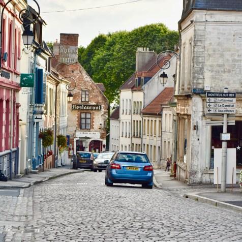 Boulogne GastroGays pas de calais Montreuil cobbled street shops cars