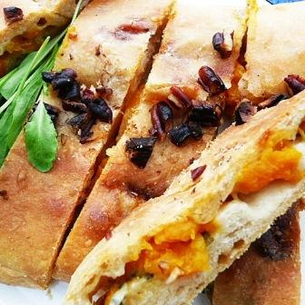 slices of sage, squash and stilton calzone