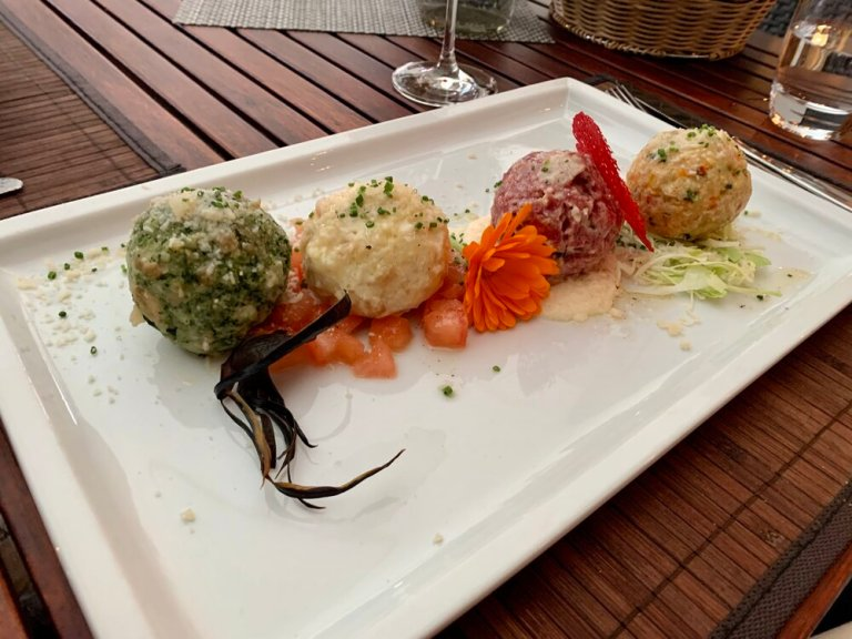 You must try the Canederli dumplings when visiting the Dolomites