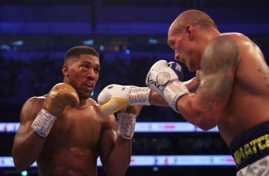 PHOTOS: Uysk Defeats Anthony Joshua To Hold Heavyweight Titles