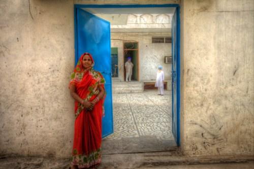 Red Sari and Blue Door