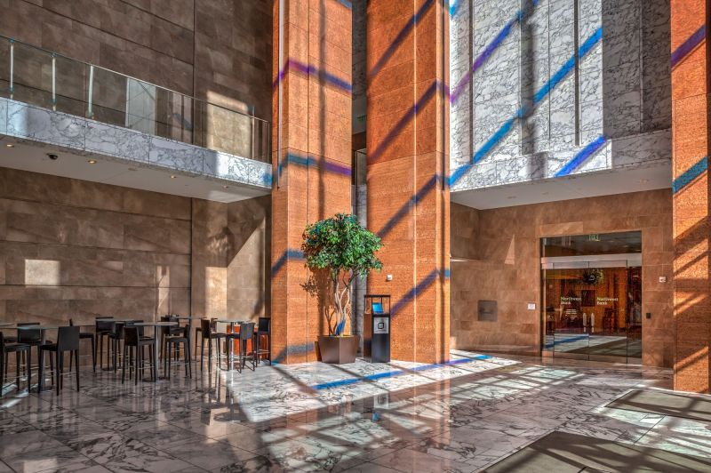 Lobby of the building if you enter frm 3rd Avenue. Walk towards Northwest Bank and follow the hallway around the corner