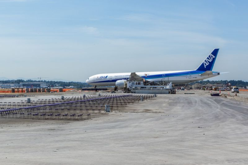 ANA Boeing 777 crossing the center runway.