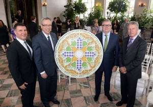 From left to right: Casa Loma CEO Nick Di Donato; Minister of Finance Joe Oliver; Andrew McCausland, President of Robert McCausland Ltd; and Royal Canadian Mint Interim President and CEO Marc Brûlé unveil a silver collector coin celebrating the art of Casa Loma's stained glass on August 5, 2014 in Casa Loma's conservatory in Toronto. (CNW Group/Royal Canadian Mint)