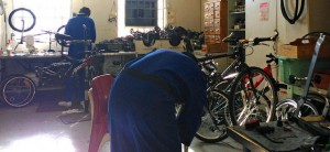 Under the supervision of correctional peace officers, offenders learn valuable skills while repairing old bicycles.