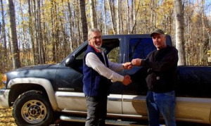 Thanks to the generosity of Quinn Leder (right) and Supreme Steel, the Wilderness Youth Challenge Program, headed by Lee Eskdale (left), has a new truck to continue operations.