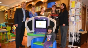 (Back L-R) Roy Hebert, Alberta Territory Executive, IBM Canada; Cheryl Dalwood, Director, Alberta's Promise; Laura Burton-Kopustas, Coordinator - Strategic Partnerships and Community Engagement, Alberta's Promise; Colleen Clancy, Development & Communications Specialist, Children's Cottage Society; Dawn Boustead, Manager, Brenda's House. (Front) Tyra Nataliah, Brenda's House resident with a new Young Explorer workstation.