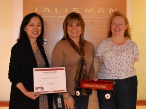 Talisman Energy Inc. becomes an Alberta's Promise partner! (L-R) Judy Eng-Hum, Executive Director with Alberta's Promise; Gina Chavez, Community Involvement Advisor with Talisman Energy; and Marie Olney, Volunteer Program Advisor with Talisman Energy.