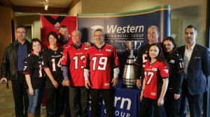 From L to R: - Gordon Norrie, President, Calgary Stampeders - Marni McDonald, e-Business Coordinator, Western Direct Insurance - Alison Stokes, e-Business Manager, Western Direct Insurance - Blake Reichert, SVP Sales, Western Financial Group - Rod Cunniam, COO Direct Distribution, Western Direct Insurance - Joe Sirianni, EVP Sales, Western Financial Group - Jeff Burke, President and CEO, Western Financial Group - Kelsie Bowen, Business Development Manager, Western Direct Insurance - Lindsay Cowling, Director, Western Direct Insurance - Mike Mungiello, Senior Director, Corporate Sponsorships, Calgary Flames and Calgary Stampeders