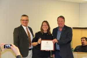 Deanna Hintze receives her medal from Councillor Gerald Pfeil and MLA Pat Stier (Photo: Town of Turner Valley)
