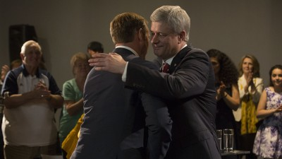 Prime Minister Stephen Harper shakes hands with Peter MacKay, Minister of Justice and Attorney General of Canada, after delivering remarks at a press conference in Nova Scotia.
