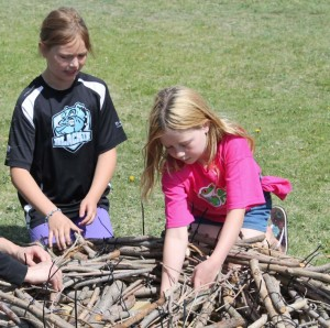 Blackie students working on a Ferruginous Hawk nest to be placed on a stand