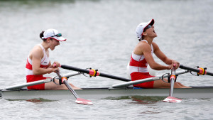 Liz Fenje (left) and Kate Sauks (right) celebrate after winning the women's lightweight double scull at the Pan Am Games July 14, 2015.