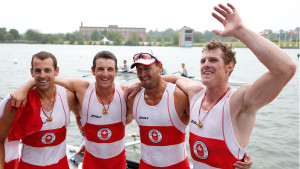 Matthew Buie, Julien Bahain, Rob Gibson and Will Dean (left to right) after winning gold in men's quadruple sculls at the Pan Am Games July 14, 2015.