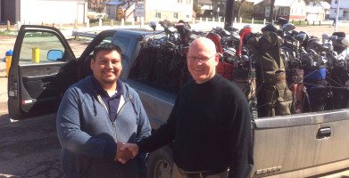 Band Councilor Hughie Tallman of Whitefish Lake First Nation (left) partnered with Sheldon Oleksyn, Executive Director of Sport Central (right), to distribute 50 sets of golf clubs to Aboriginal youth.