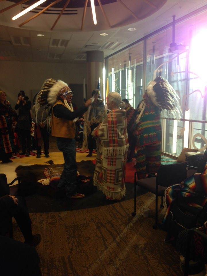 Elder Clarence Wolfleg led the ceremony and gave Val her new Blackfoot name: Ninapiitaakii (Chief Eagle Woman)