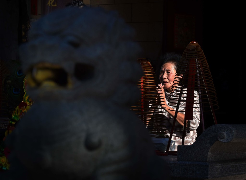 A woman prays at the Thien Hau Temple on the eve of the Lunar New Year which will be the Year of the Monkey, in Los Angeles, California on February 7, 2016. (Getty)