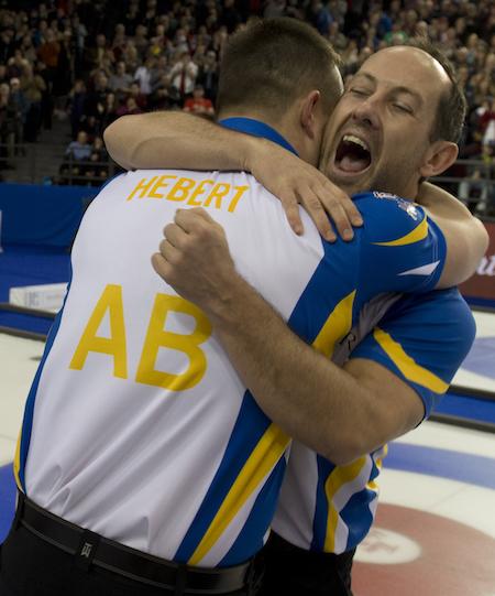 Alberta's Ben Hebert, left, and Brent Laing celebrate their Tim Hortons Brier win. (Photo, Curling Canada/Michael Burns)