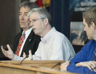 Gary Wick, center, answers a question from the media at NASA Armstrong. Robert Webb, left, and Jason Sippel, right, also fielded questions. Credits: NASA Photo / Ken Ulbrich