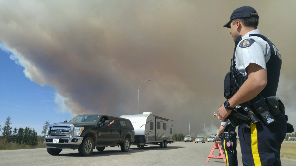 Thumbs up from evacuee leaving Fort McMurray with the convoy.