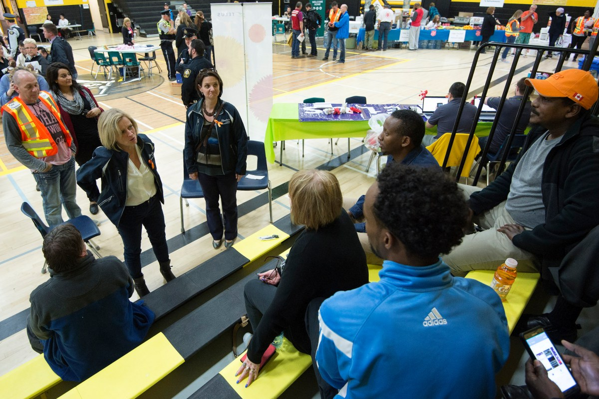 Premier Rachel Notley and Municipal Affairs Minister Danielle Larivee chat with returning Fort McMurray residents on the first day they are allowed back into the city, June 1, 2016. (photography by Chris Schwarz/Government of Alberta)