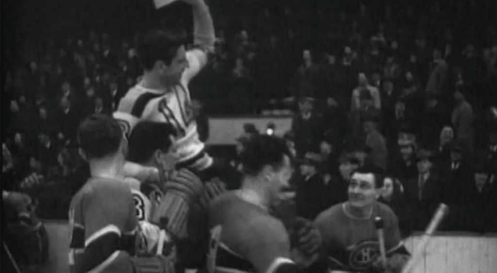 Milt Schmidt, a member of the NHL's famed Kraut Line, is carried off the ice by members of the Boston Bruins and Montreal Canadiens at the end of his last game before reporting for duty with the Royal Canadian Air Force in February 1942.