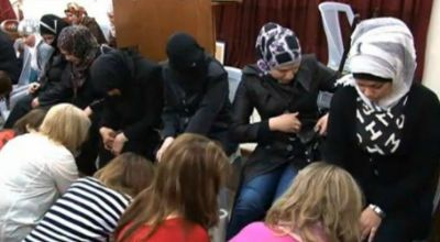 Missionaries from E3 Partners invited Syrians to hear about Jesus and take part in a foot-washing ceremony. (CBN News).