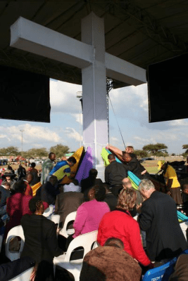 Prayers around a giant cross at the stadium event.