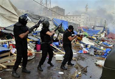 Mostafa Darwish / EPA Egyptian security forces move in to clear one of the two sit-in sites of supporters of ousted president Morsi, Wednesday.