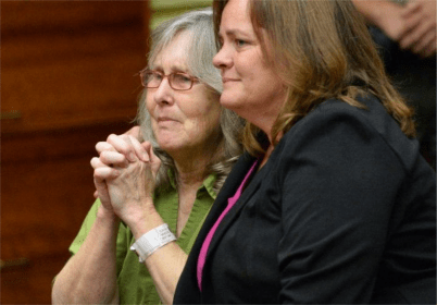 Susan Mellen, left, sits with her attorney Deirdre O'Connor, as she is exonerated of murder by Superior Court Judge Mark Arnold in Torrance, Calif., Friday, Oct. 10, 2014. Mellen spent 17 years in prison after being convicted of murder in the death of Richard Daly, a homeless man in 1997. The judge said Mellen had inadequate representation by her attorney at trial. The witness who claimed she heard Mellen confess, had a long history of giving false tips to law enforcement, according to documents in the case. Three gang members subsequently were linked to the crime, and one was convicted of the killing. (AP Photo/Daily Breeze, Brad Graverson, Pool ) (The Associated Press)