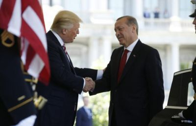 US President Donald Trump (L) welcomes Turkey's President Recep Tayyip Erdogan at the entrance to the West Wing of the White House yesterday. (PHOTO: Reuters)