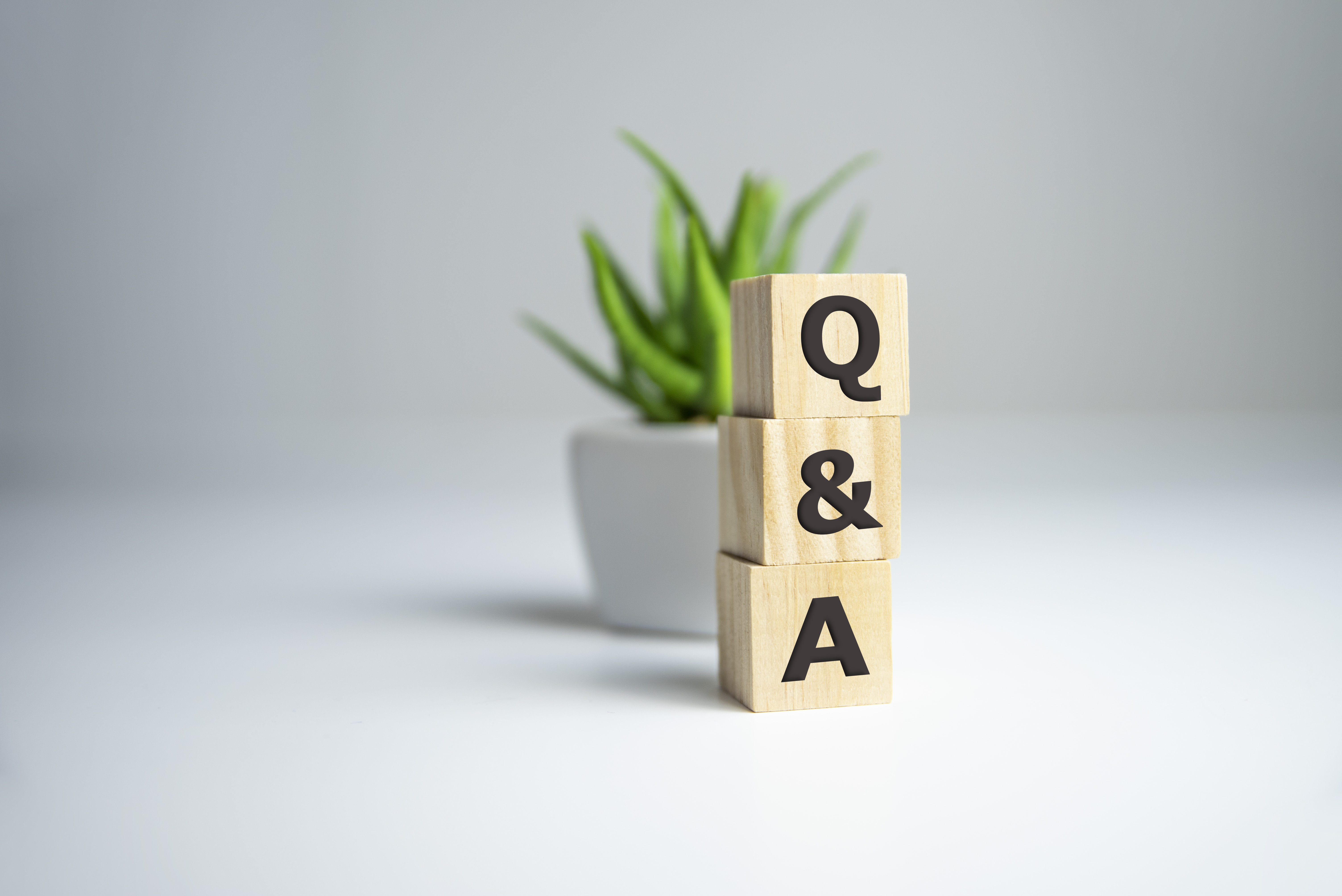 Q A or Questions and answers on black block with sunshine background