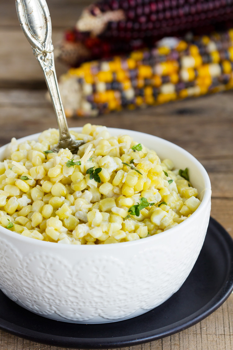 Creamy Parmesan Baked Corn - Blend of sweet corn, fresh Parmesan and a cream sauce made with half and half. Perfect baked summer side dish and holiday favorite. My family loves this casserole.
