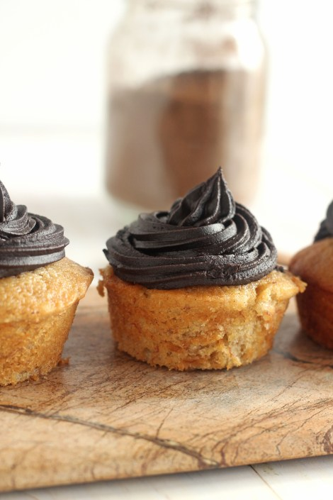 Banana Cupcakes with Dark Chocolate Frosting | A moist banana cupcake topped with rich dark chocolate frosting