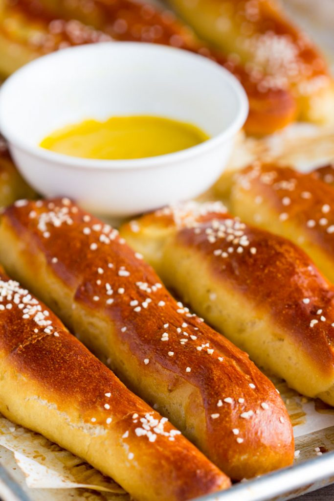 German Soft Pretzel Sticks - How to make homemade slightly sweet golden soft pretzel sticks with yeast. Makes enough for a crowd as an appetizer and great for the big game.