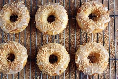 Peach donuts with white chocolate coconut glaze