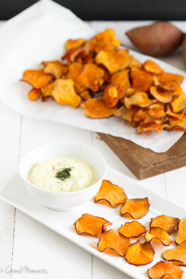 Baked Sweet Potato Chips - Crisp, delicious, salty baked sweet potato chips make the perfect healthy snack. Just 4 simple ingredients. Combine with this fresh dip. Paleo, Whole 30 approved.