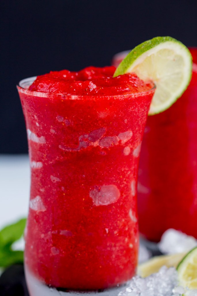 Strawberry Lime Slush - Fruit slushies are the perfect summer drink. Made with real fruit these are easy to make at home and you'll be sipping this icee drink in minutes.
