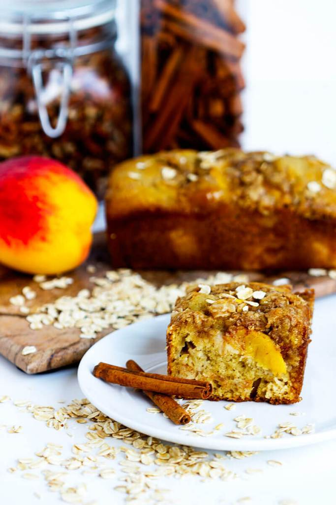 Peach Streusel Quick Bread - Delicious fruity quick bread made with fresh peaches and topped with a crunchy oat streusel.