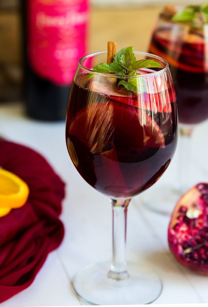 Pomegranate Orange Sangria - Wonderful blend of red wine pomegranate, orange and apple for a festive cocktail. Delish!