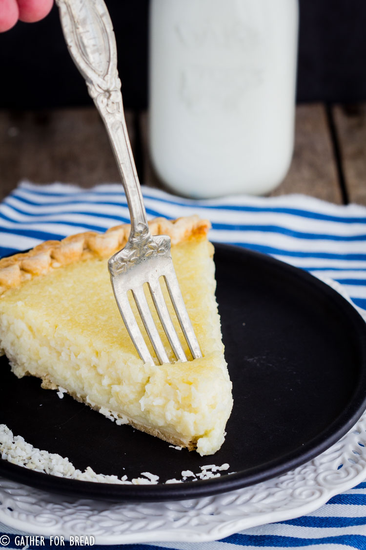 Homemade Coconut Custard Pie - Flaky coconut pie made with real custard baked in a pie crust for a perfect old fashioned taste, just like grandma made. Real ingredients like eggs, coconut milk and organic sugar.
