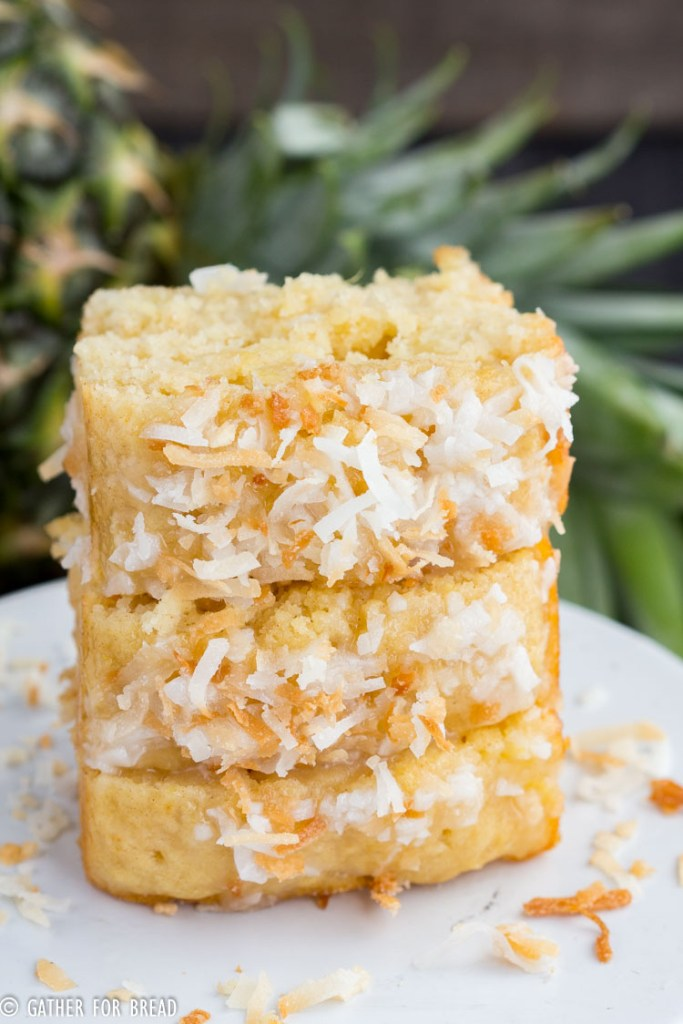 Pina Colada Quick Bread - Moist mini loaves with pineapple, coconut cream for a fresh Hawaiian taste of the tropics in a quick easy batch of bread. Decadent, moist and delicious, you'll be mix and make this often if you love the tropical taste.