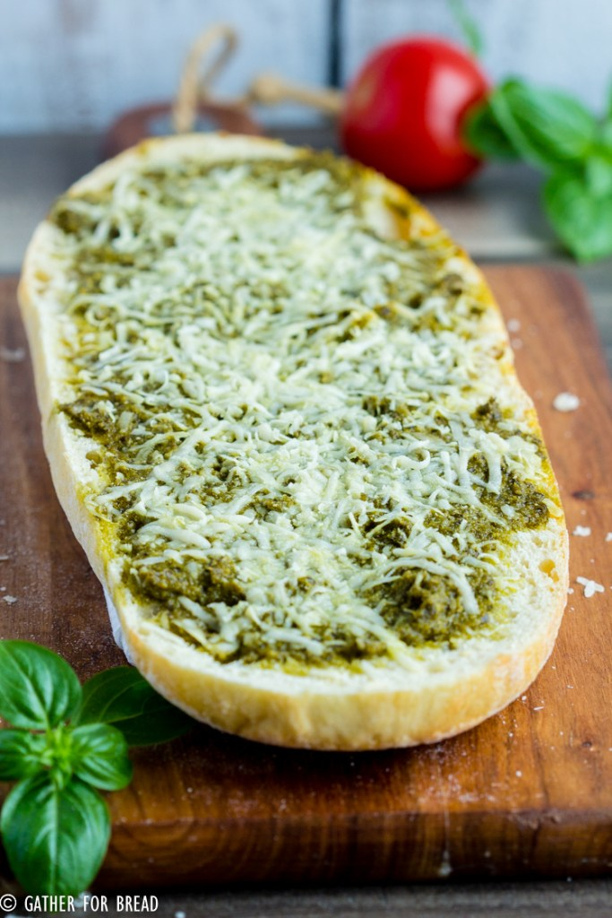 Cheesy Pesto Bread - Italian Bread with Pesto and Parmesan cheese. Easy recipe, ready in minutes as an appetizer or side dish. Perfect for potlucks or picnics.