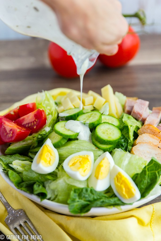 Chef's Salad - Popular American salad with ham, turkey cheese, hard boiled eggs, tomatoes cucumbers on a bed of lettuce. It's got color, crunch and it tastes AMAZING!!