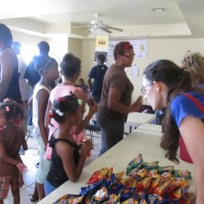 Providing a meal and school supplies in Desire